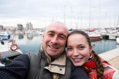 Portrait of cheerful girl and adult man outdoors Stock Photo