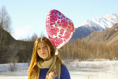 Portrait cheerful girl with a balloon and a package with a gift Royalty Free Stock Images