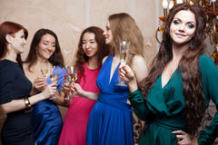 Portrait of cheerful girl with champagne Stock Images