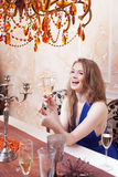 Portrait of cheerful girl with champagne Stock Image