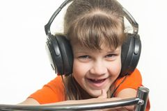 Portrait of cheerful girl with headphones Stock Photo