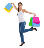 Portrait of cheerful girl with shopping bags Stock Photos