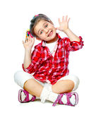 Portrait of a cheerful girl sitting on the floor Stock Photo