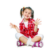 Portrait of a cheerful girl sitting on the floor Stock Photography