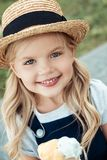 portrait of cheerful girl in straw hat looking royalty free stock images