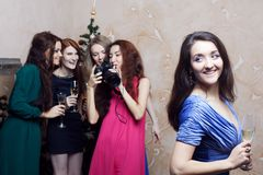 Portrait of cheerful girls at the Cristmas party Royalty Free Stock Image