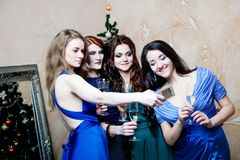 Portrait of cheerful girls at the Cristmas party Royalty Free Stock Photos
