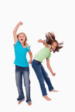 Portrait of cheerful girls jumping Stock Photos