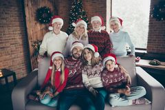 Portrait of cheerful glad full diverse family, noel gathering, m royalty free stock photography