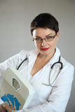 Portrait of cheerful happy doctor in hospital. Friendly female doctor. Portrait of cheerful happy doctor in hospital. Portrait of a friendly female doctor Royalty Free Stock Images