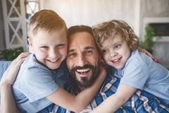 Outgoing father with glad kids royalty free stock photography