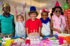 Portrait of cheerful kids at table Royalty Free Stock Photography