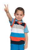 Cheerful little boy shows victory sign Royalty Free Stock Photos
