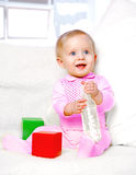 Portrait of a cheerful little girl drinking water from a bottle Stock Photo