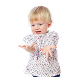 Portrait of a cheerful  little girl at home, in the dress, 1,5 Royalty Free Stock Photos