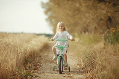 Portrait of a cheerful little girl at nature Royalty Free Stock Photo
