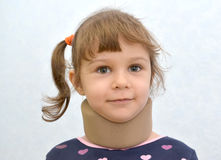 Portrait of the cheerful little girl with an orthopedic collar Royalty Free Stock Photos