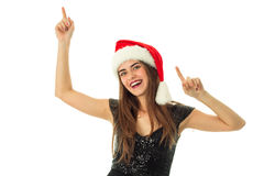 Portrait of cheerful lovely woman in santa hat. Looking and smiling on camera in studio isolated on white Royalty Free Stock Images
