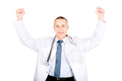 Portrait of cheerful male doctor with raised arms.  Royalty Free Stock Photo