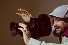 Portrait of cheerful man with a beard makes movies Royalty Free Stock Image