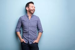 Cheerful man with beard posing against blue wall Stock Images