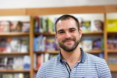 Portrait of cheerful man in a bookstore Royalty Free Stock Images