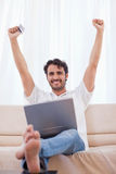 Portrait of a cheerful man buying online Stock Images