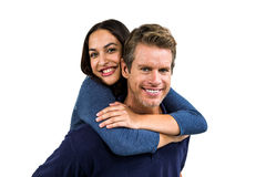 Portrait of cheerful man carrying girlfriend on back Royalty Free Stock Photo