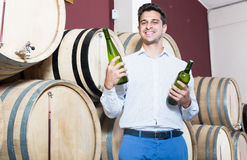 Portrait of cheerful man customer having bottle of wine Stock Photography