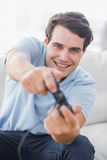 Portrait of a cheerful man playing video games Stock Photography
