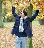 Portrait of a cheerful man relaxing on an Autumn day Stock Photography