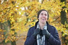 Portrait of a cheerful man smiling outdoors on a fall day Royalty Free Stock Images