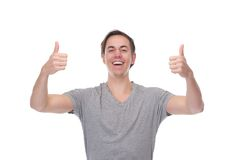 Portrait of a cheerful man smiling with thumbs up Royalty Free Stock Photos