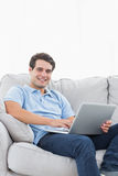 Portrait of a cheerful man using his laptop Royalty Free Stock Image
