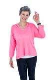 Portrait of cheerful mature woman showing OK sign Stock Photos