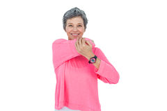 Portrait of cheerful mature woman stretching Stock Photos