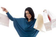 Portrait of cheerful model with carry bags Stock Photos