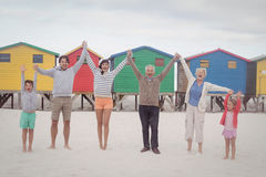 Portrait of cheerful multi-generation family holding hands at beach. Portrait of cheerful multi-generation family holding hands while standing at beach Stock Images