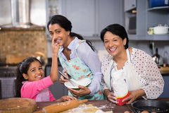 Portrait of cheerful multi-generation family preparing food together Stock Images