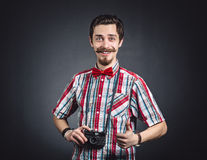 Portrait of a cheerful photographer Royalty Free Stock Photos