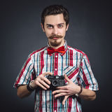 Portrait of a cheerful photographer Stock Images