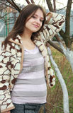 Portrait of cheerful pregnant woman near the tree Royalty Free Stock Photography