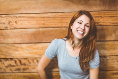 Portrait of a cheerful pretty redhead laughing Royalty Free Stock Image
