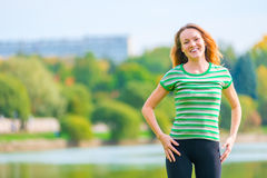 Portrait of cheerful red-haired girl Stock Images