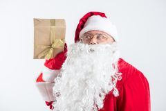 Curious Father Frost showing colorful present Stock Photography