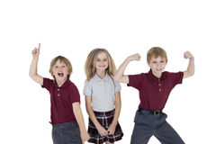 Portrait of cheerful school children over white background Royalty Free Stock Photography