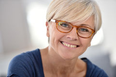 Portrait of cheerful senior woman wearing eyeglasses Royalty Free Stock Images