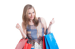 Portrait of cheerful smiling woman with shopping bags looking excited Royalty Free Stock Photo