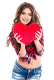 Portrait of cheerful smiling young woman showing red heart Royalty Free Stock Image