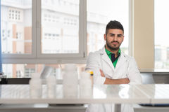 Portrait Of Cheerful Student Man Standing In Class Stock Images